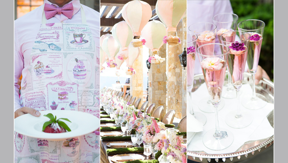 pink champagne with edible flowers, mini hot air balloons hanging as decor over a dinner table,  a waiter holding dessert