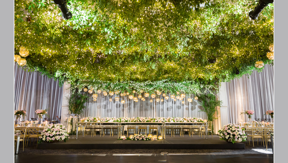 wedding decor, ceiling covered in greenery and mini white lights, luxury wedding design