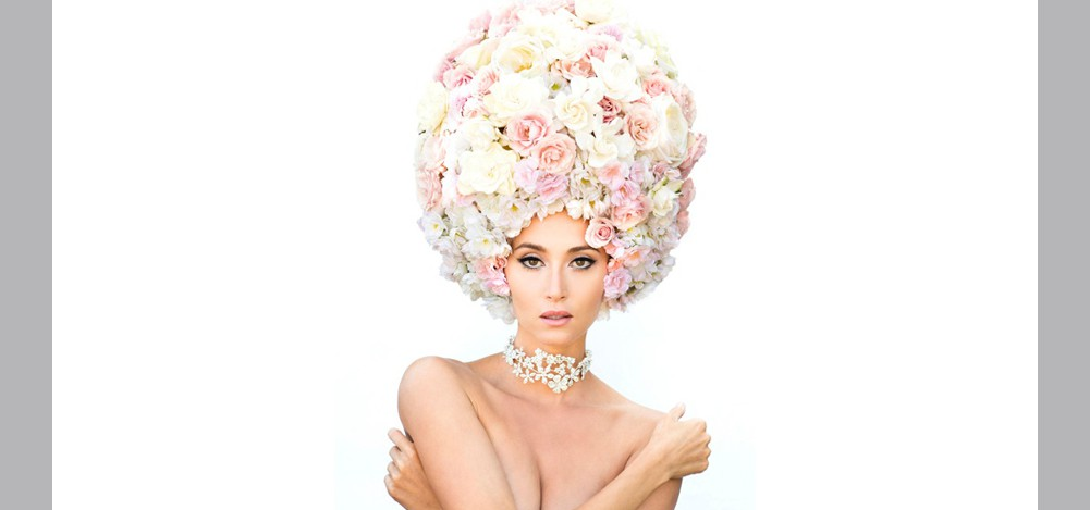 editorial photo, woman wearing flowers on her head and a diamond necklace