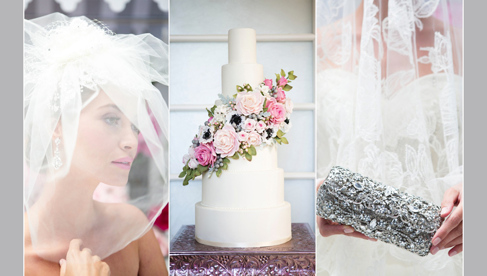 bride wearing a veil, wedding cake with pink flowers, silver clutch person in brides hands